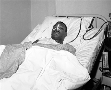 FILE - In this Sept. 21, 1958 file photo, Martin Luther King Jr. recovers from surgery in bed at New York