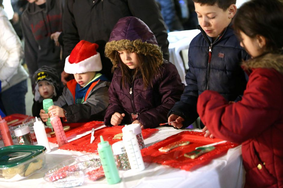Children decorate cookies at The Light Hangar Co. booth during the annual Southington White Christmas in the Community event on Friday night, Dec. 6, 2019. Emily J. Tilley, special to the Record-Journal.