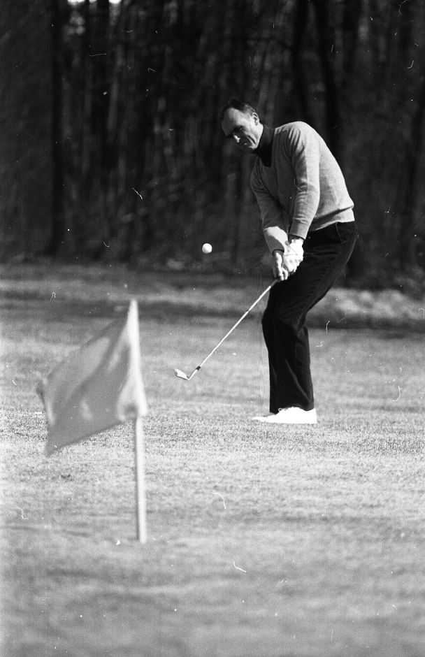RJ file photo - John Sullivan capitalizes on the unseasonably warm weather to play his first round of golf of the year at Wallingford Country Club March 16, 1989.