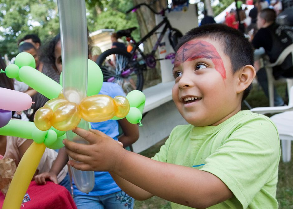 Alexis Lozano, 5, of Meriden gets a balloon sword made by baloon bender Kurt Beckley while at the seventh annual National Night Out at City Park in Meriden Tuesday August 7, 2012. (Dave Zajac/Record-Journal)