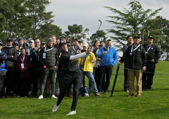 Jordan Spieth follows his shot up to the 18th green of the Spyglass Hill Golf Course during the second round of the AT&T Pebble Beach National Pro-Am golf tournament Friday, Feb. 8, 2019, in Pebble Beach, Calif. (AP Photo/Eric Risberg)