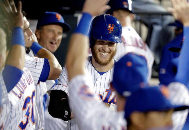 New York Mets starting pitcher Zack Wheeler smiles while celebrating with teammates after hitting a home run during the fourth inning of a baseball game against the Philadelphia Phillies Tuesday, April 23, 2019, in New York. (AP Photo/Frank Franklin II)