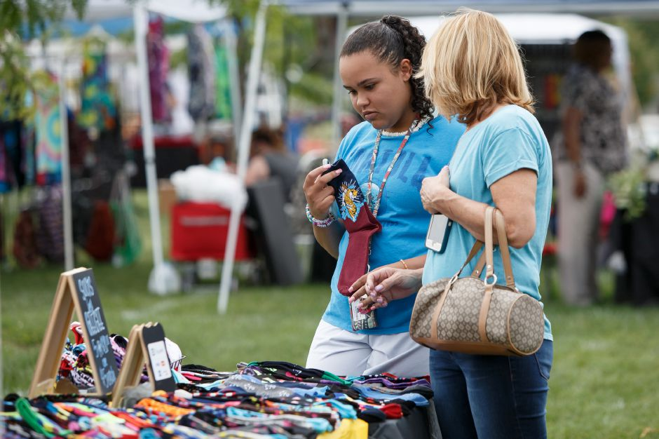Jayla Johnson 13 and her mom Amy pick out some colorful socks at GeeGee store Saturday during a pop up market on the Meriden Green in Meriden September 1, 2018 | Justin Weekes / Special to the Record-Journal