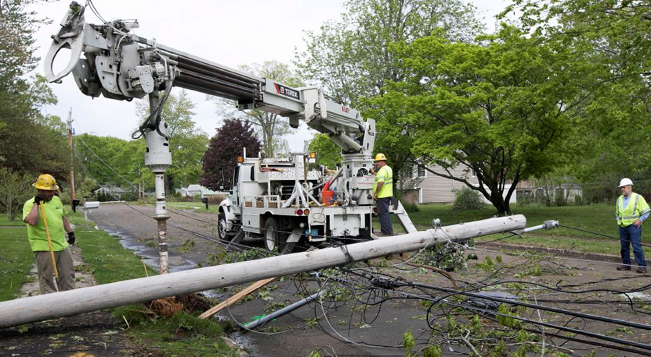 Utility crews from Wakefield Mass. based Wakefield Municipal Gas & Light, work on the scene of a downed utility pole on Blakeslee Road in Wallingford, Thursday, May 17, 2018. Dave Zajac, Record-Journal