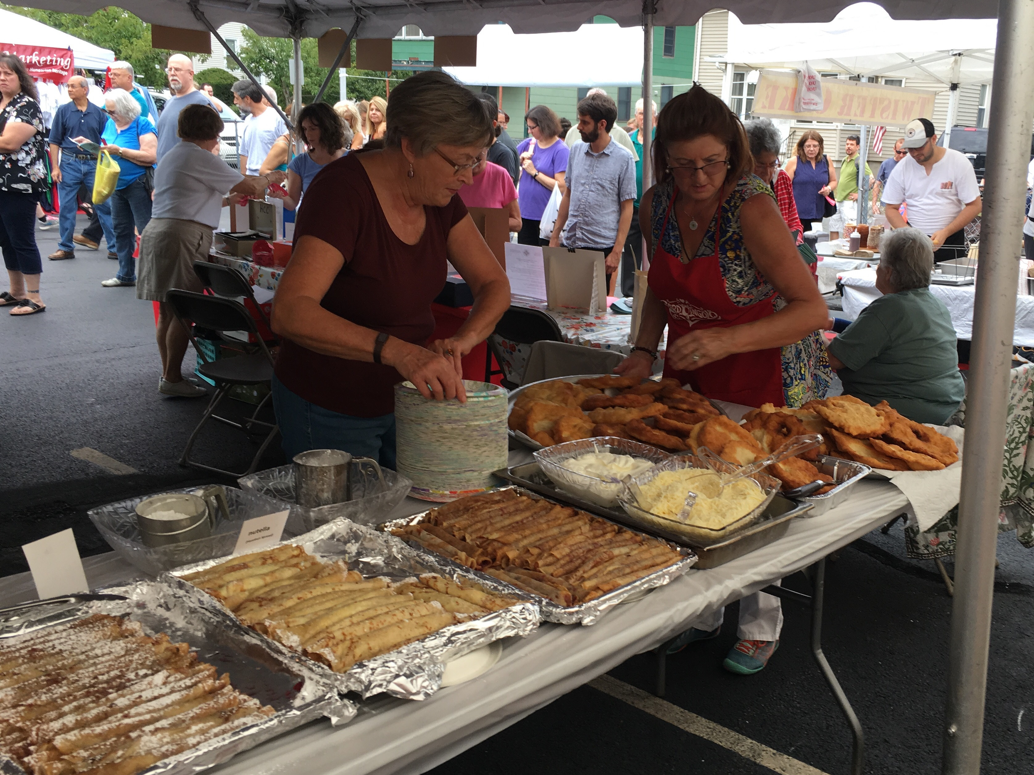 A food tent offered several kinds of Hungarian food, including stuffed cabbage, kolbasz, chicken paprikash and gulyas, Sunday at the annual Hungarian Community Club festival. | Lauren Takores, For the Record-Journal