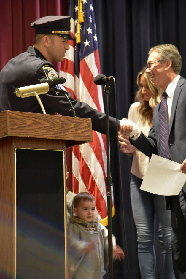 North Haven policeman John Gaspar is sworn-in as a sergeant by board of police commissioners chairman David Monz, during a special meeting at the middle school on Jan. 15, 2019. | Bailey Wright, Record-Journal