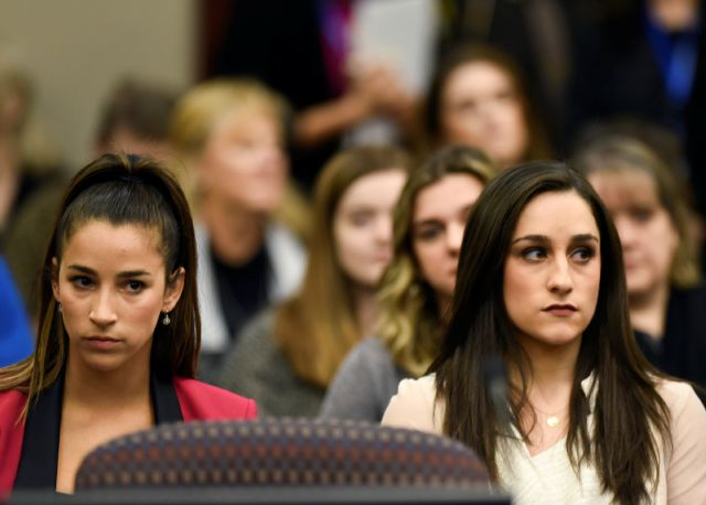 Former Olympians Aly Raisman, left, and Jordyn Wieber sit in Circuit Judge Rosemarie Aquilina