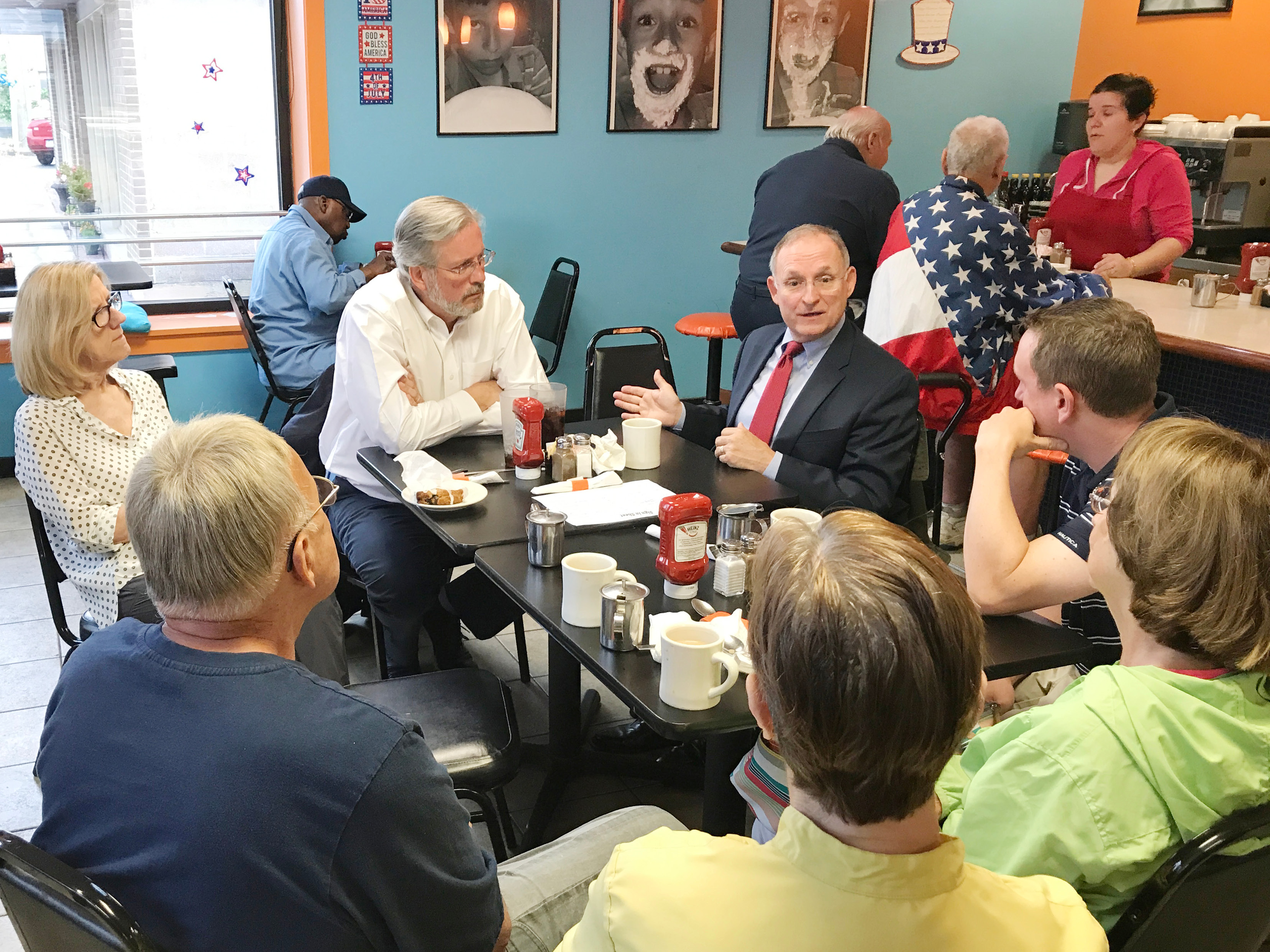 Rep. William Petit (center left) and Sen. Henri Martin (center right) met with Plainville constituents during a recent coffee hour at Bolo Bakers.