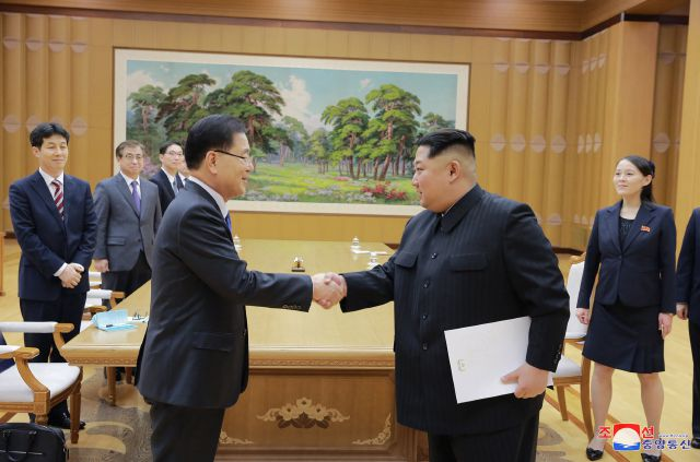 In this Monday, March 5, 2018 photo, provided by the North Korean government on March 6, North Korean leader Kim Jong Un, front right, shakes hands with South Korean National Security Director Chung Eui-yong after Chung gave Kim the letter from South Korean President Moon Jae-in, in Pyongyang, North Korea. Independent journalists were not given access to cover the event depicted in this image distributed by the North Korean government. The content of this image is as provided and cannot...