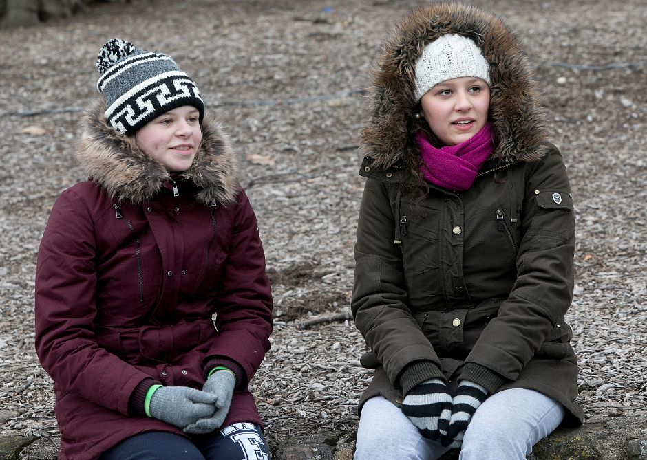 Natalie Scotto, 15, left, and sister, Deanna, 21, of Meriden, rest on a rock wall after skating around Mirror Lake at Hubbard Park in Meriden, Monday, Jan. 15, 2018. For the first time in more than 10 years, Hubbard Park is open to public skating. Dave Zajac, Record-Journal