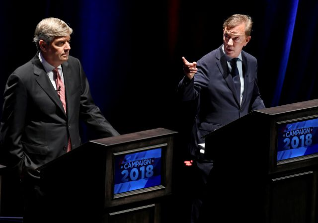Democratic Party candidate Ned Lamont, right, gestures toward Republican Party candidate Bob Stefanowski during a gubernatorial debate at the University of Connecticut in Storrs, Conn., Wednesday, Sept. 26, 2018. (AP Photo/Jessica Hill)