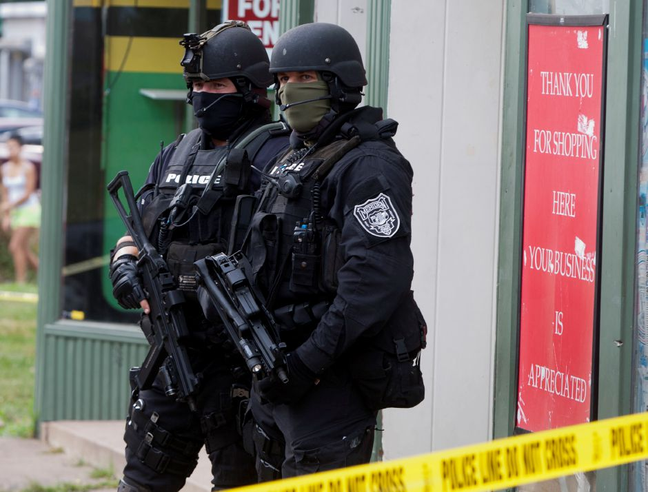 Two Meriden Police SWAT officer stand outside of 251 West Main Street after raiding an apartment on the third floor of the building Monday afternoon, July 23, 2012. (Christopher Zajac / Record-Journal)