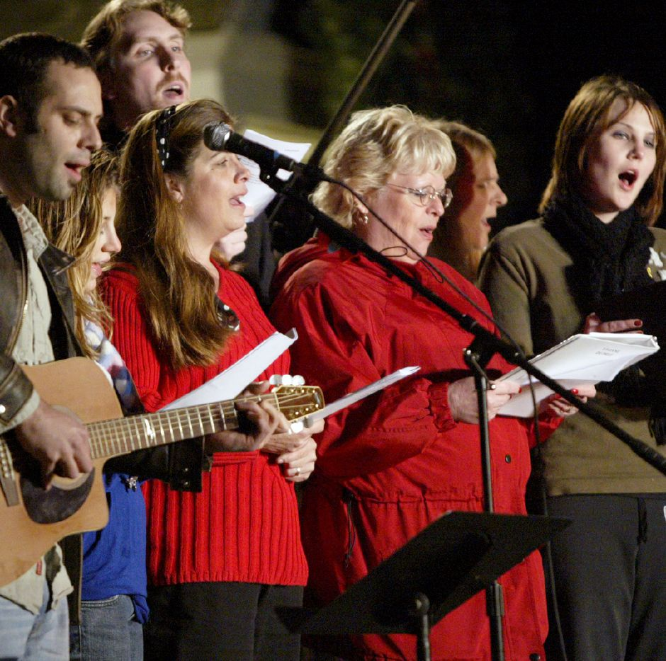 SOUTHINGTON, Connecticut - Thursday, December 3, 2009 - Christmas carols are sung by the Faith Living Church choir during the annual Christmas in teh Village celebration in downtown Plantsville on Thursday, December 3. Rob Beecher / Record-Journal