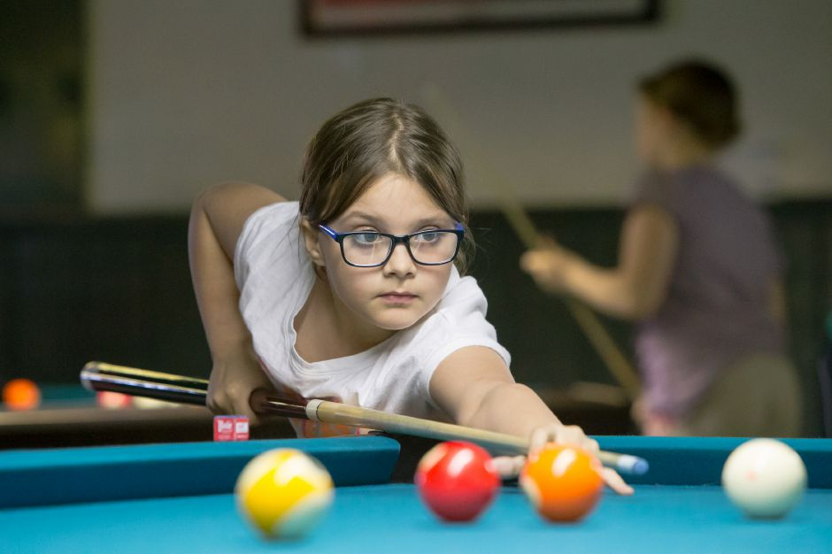 Emily Lowe 10 of Southington lines up a shot during a tournament with the APA Junior Academy Wednesday at the Shooters Billiards and Arcade in Southington Apr. 5, 2017 | Justin Weekes / For the Record-Journal