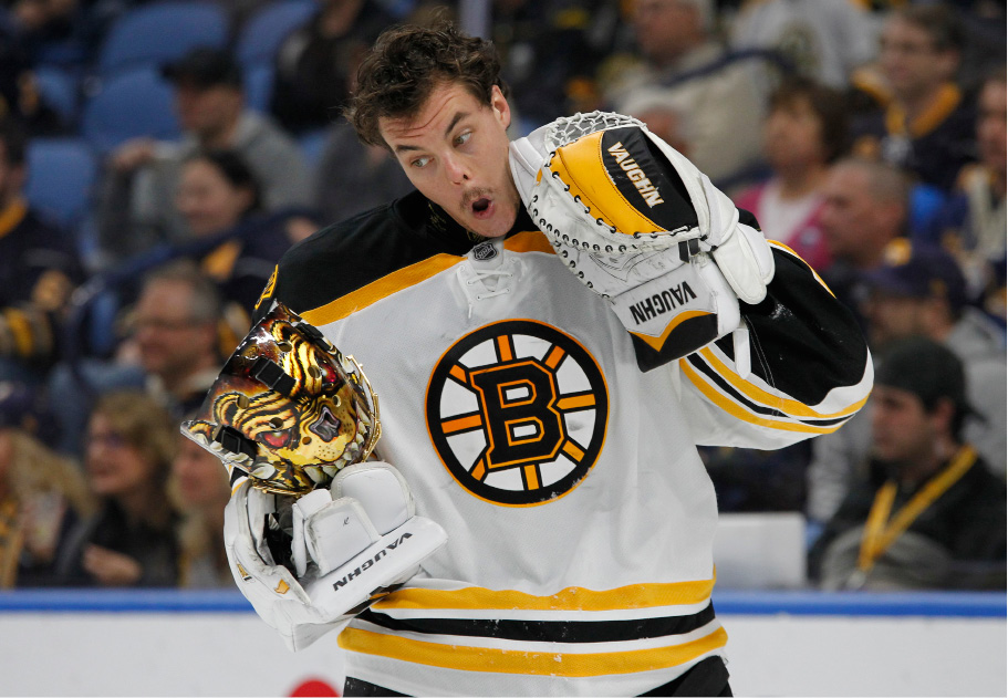 Boston Bruins goalie Tuukka Rask (40) reacts after being hit with a high stick during the first period of an NHL hockey game against the Buffalo Sabres, Saturday, Dec. 3, 2016, in Buffalo, N.Y. (AP Photo/Jeffrey T. Barnes)