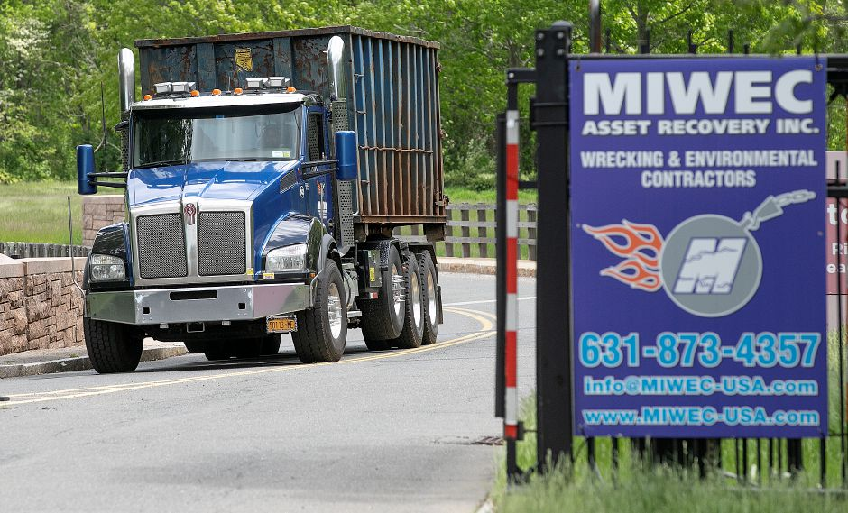 A truck exits the former Bristol-Myers Squibb property at 5 Research Pkwy. in Wallingford, Fri., May 24, 2019. Demolition began on the facility this week. Dave Zajac, Record-Journal