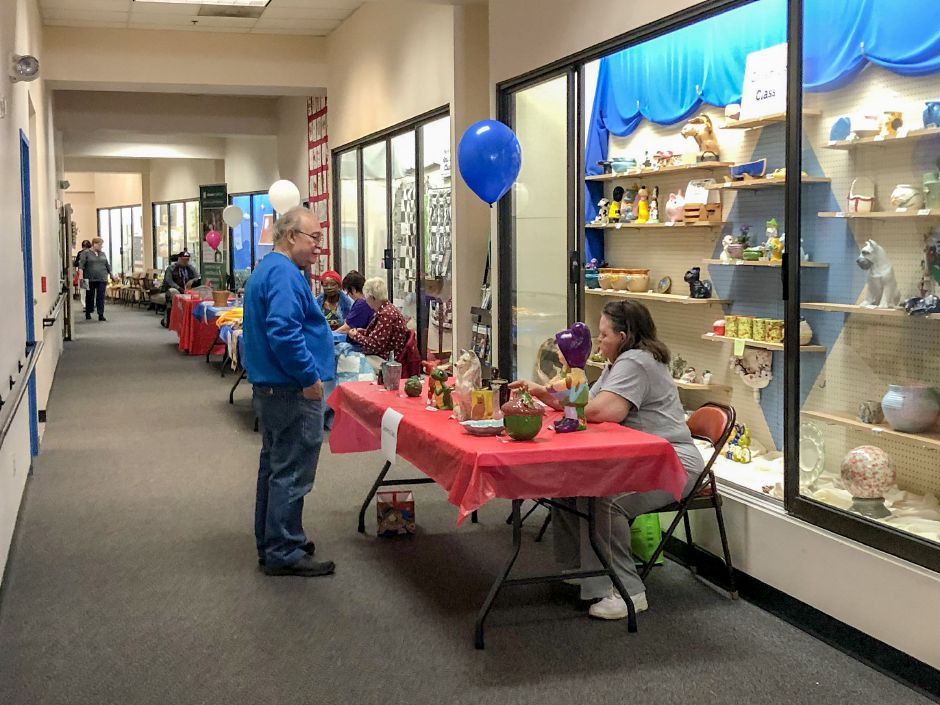 Guest standing in the crafts display hallway on the second story of the Meriden Senior Center at the Senior Health Fair, Wednesday, May 8, 2019 | Kristen Dearborn, Special to the Record-Journal