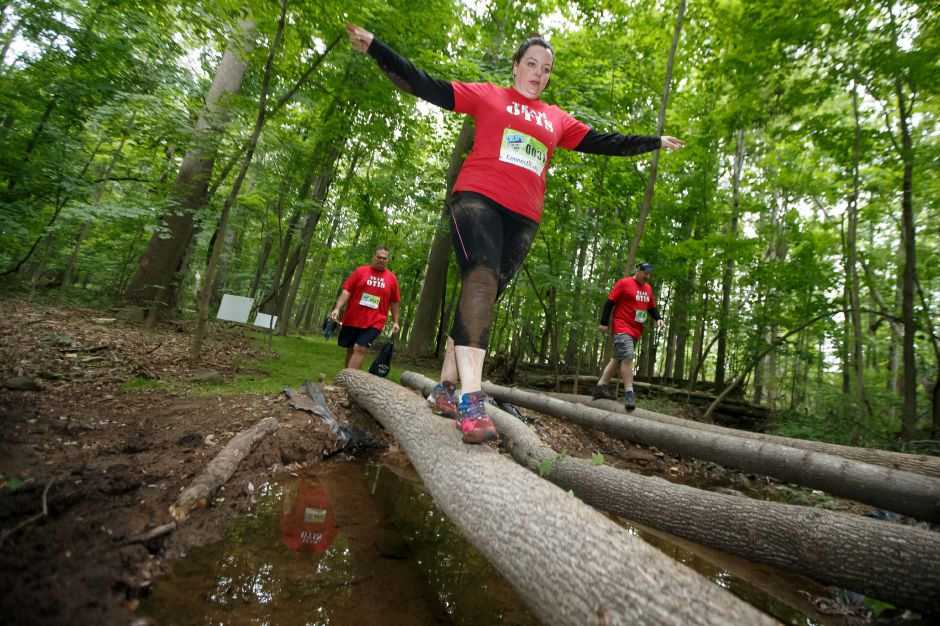 "Sue Hilerio of Newintin keeps her balance on the ""Loss of Balance"" obstacle Saturday during the 5th annual Gaylord Gauntlet 5k Trail & Obstacle Race at Gaylord Hospital in Wallingford June 23, 2018 