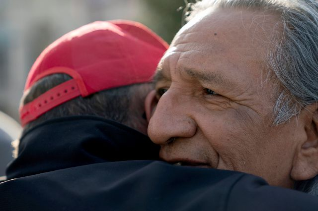 Guy Jones, left, and a supporter of President Donald Trump named Don embrace during a gathering of Native American supporters in front of the Catholic Diocese of Covington in Covington, Ky., Tuesday, Jan. 22, 2019. Jones organized Tuesday