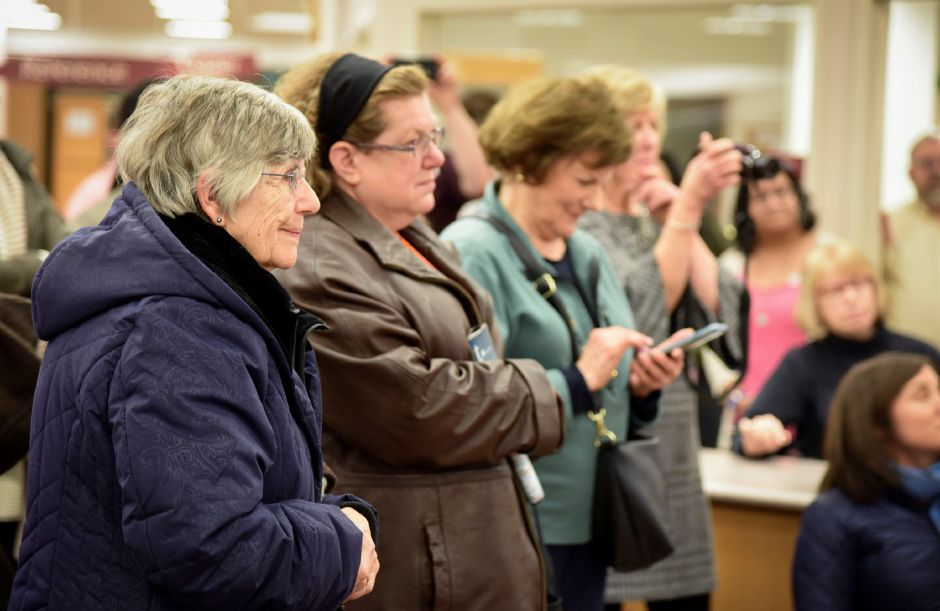 Community members react to the reveal of the One Book One Wallingford novel chosen, at the public library