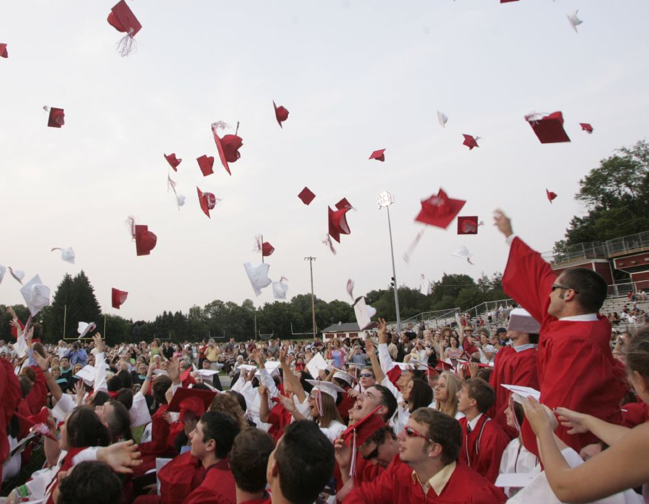 Cheshire graduates celebrate at the conclusion of commencement ceremonies at Cheshire High School June 20, 2007. (dave zajac photo)
