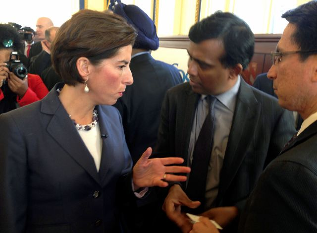 Rhode Island Gov. Gina Raimondo, left, and Infosys President Ravi Kumar, center, speak after a news conference, Monday, Nov. 27, 2017, in Providence, R.I., announcing the India-based information technology outsourcing firm will open a design and innovation hub in the state and plans to add 500 jobs there in the next five years. (AP Photo/Michelle R. Smith)