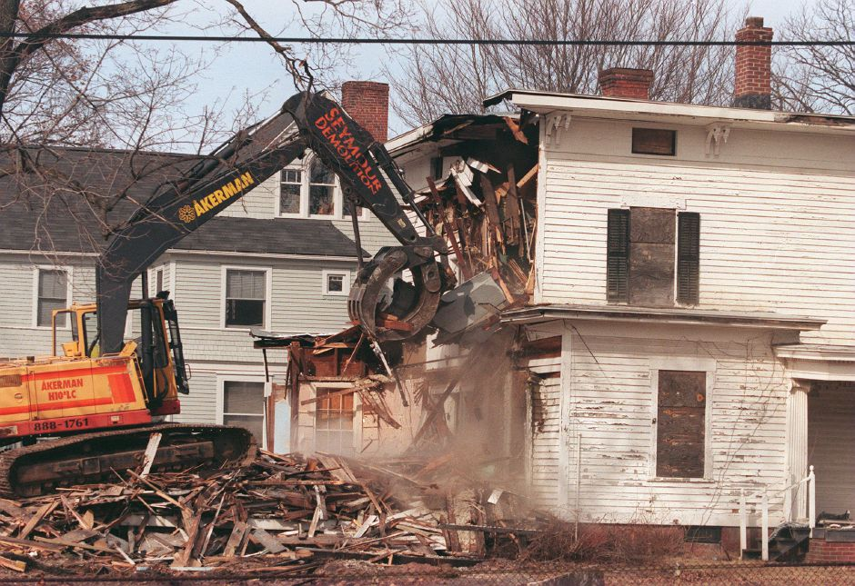 RJ file photo - The 141-year-old Oxley House at the corner of Mill and North Main streets in Southington being demolished to make room for a bank, March 1999.