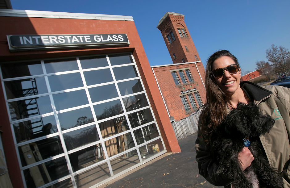 Erin DeVries, co-owner of Interstate Glass, holds dog