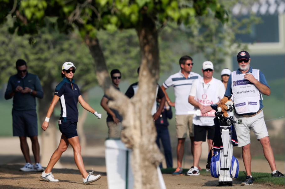 Anne-Lise Caudal of France studies her shot next to her caddie on the 10th hole during the 1st round of Dubai Ladies Masters golf tournament in Dubai, United Arab Emirates, Wednesday, Dec. 7, 2016. (AP Photo/Kamran Jebreili)