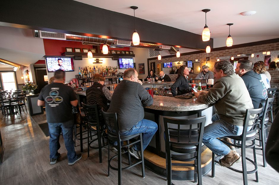 Customers sit at the bar during lunch at Amici Tavern, 43 Broadway, North Haven, Wed. Feb. 6, 2019. Dave Zajac, Record-Journal