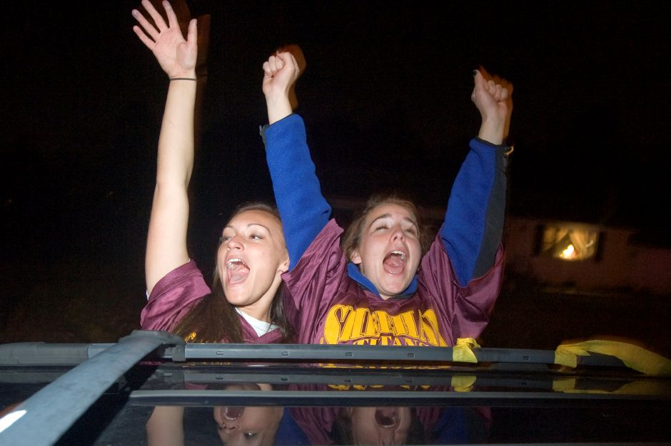 Kelly Petit, left, and Maggie Slivinski, right, both shout from the minivan they ride in outside Sheehan High School during the Powderpuff motorcade Tuesday, November 23, 2010. (Johnathon Henninger/ Record-Journal)