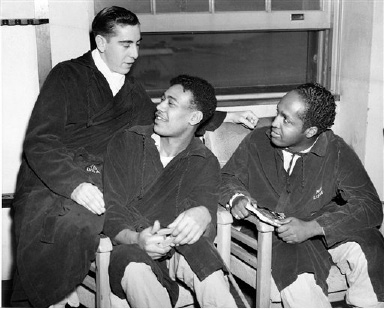 These Yanks pass the time chatting at the Halloran General Hospital in Staten Island, New York, Jan. 6, 1945, where they are recovering from their wounds. Left to right: Sgt. John D. Catello, Youngstown, Ohio, wounded in the border area of France and Germany last September; Pvt. Edward Bailey, Chicago, Ill., wounded in France on August 30, while serving with the infantr; and Sgt. Carl William Austin, Columbus, Ohio, hurt in England last August while serving with the transportation corps. (AP Photo)