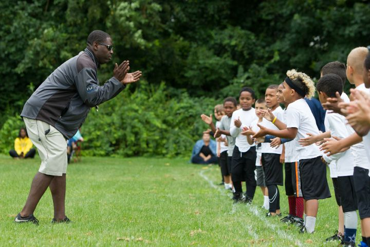 Coach Nick Inman gets his 8U team fired up for practice Monday during the Meriden Raiders youth football opening day at Washington Park in Meriden. More photos online at MyRecordJournal.com| Justin Weekes, Special to the Record-Journal