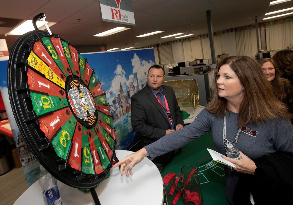 "Realtor Cheryl Rosadino from Berkshire Hathaway in Cheshire spins a raffle wheel during the 3rd Annual 4 Chamber Social ""Around the World"" hosted by the Record-Journal in Meriden, Thurs., Nov. 14, 2019. Dave Zajac, Record-Journal"