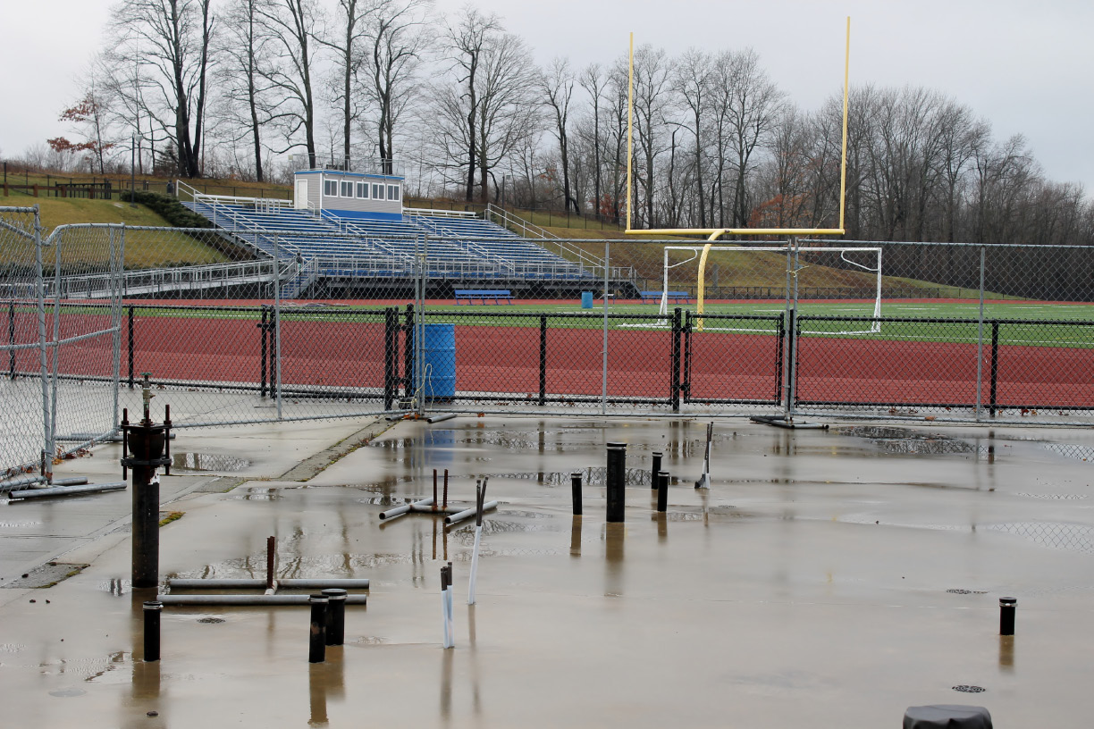 Pipes for utilities stick up from an existing foundation near the Coginchaug Regional High School athletic complex. Durham and Middlefield voters will face a referendum on May 2 to build a field house with permanent bathrooms on the site. | Mark Dionne, Town Times