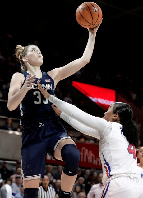 Connecticut forward Katie Lou Samuelson (33) goes up for a shot as SMU guard Mikayla Reese (4) defends in the first half of an NCAA college basketball game Saturday, Feb. 24, 2018, in Dallas. (AP Photo/Tony Gutierrez)