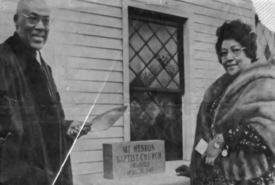 The Rev. F.H. and Mrs. Hicks pose with the new cornerstone for Mount Hebron Baptist Church on Franklin Street in the 1960s. File photo, Record-Journal