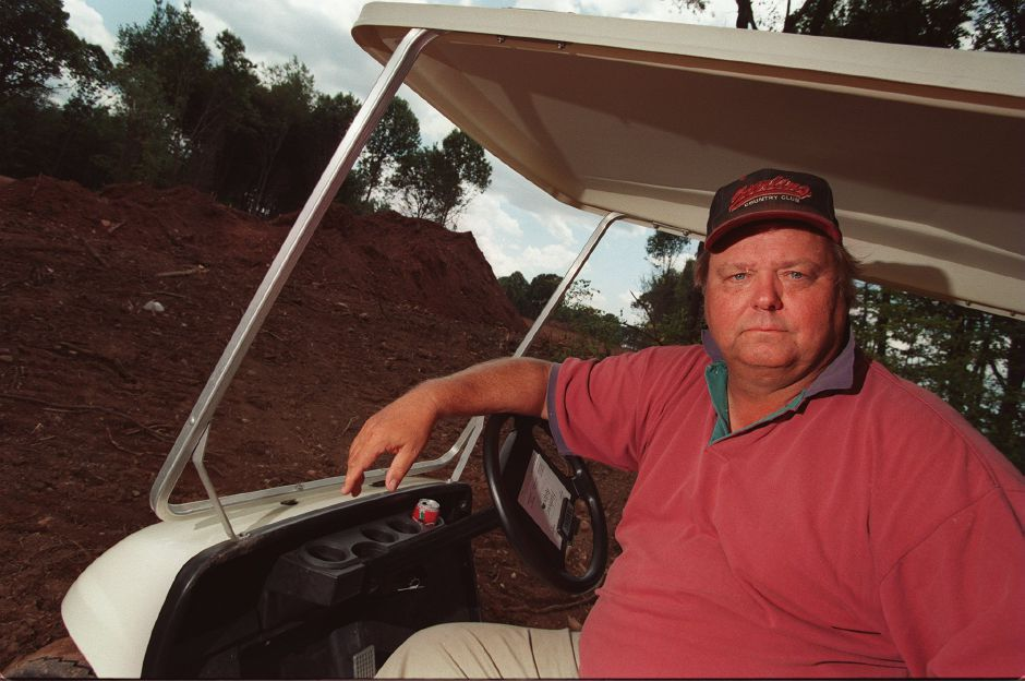 RJ file photo - Ted Manning, golf course architect on a freshly plowed section of the new course in Wallingford. August 1998.