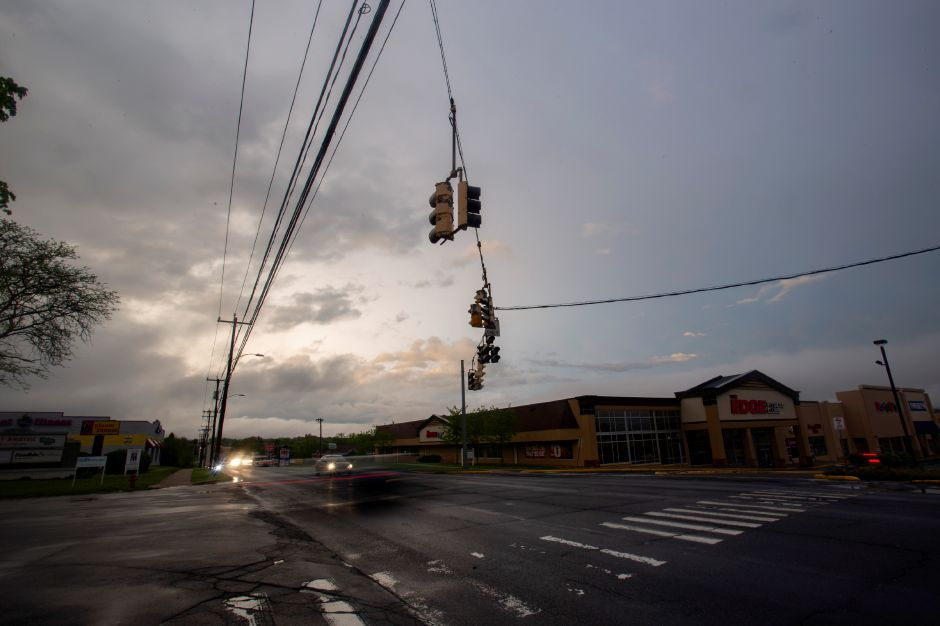 Vehicles navigate South Broad Street in Meriden near Townline Square through unpowered stop lights after the thunderstorm May 15, 2018. | Richie Rathsack, Record-Journal