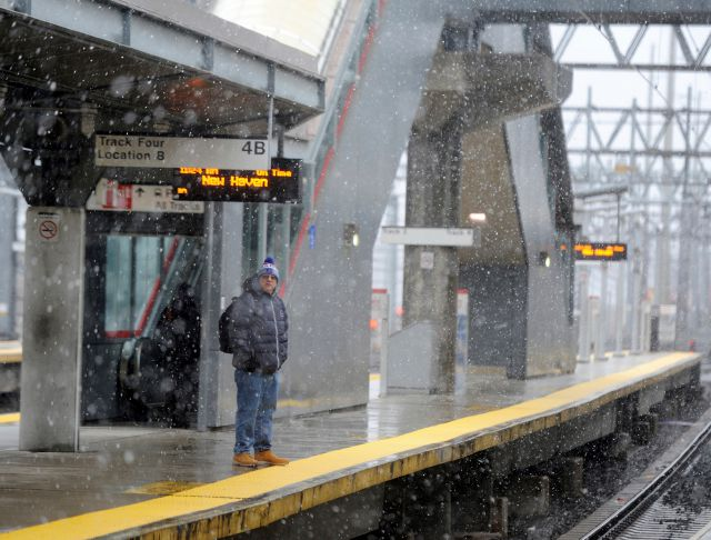 A lone commuter waits at the train station as snow falls in Stamford, Conn., Wednesday, March 7, 2018. Connecticut is expected to receive anywhere from 4 to 16 inches of snow. (Tyler Sizemore/Hearst Connecticut Media via AP)