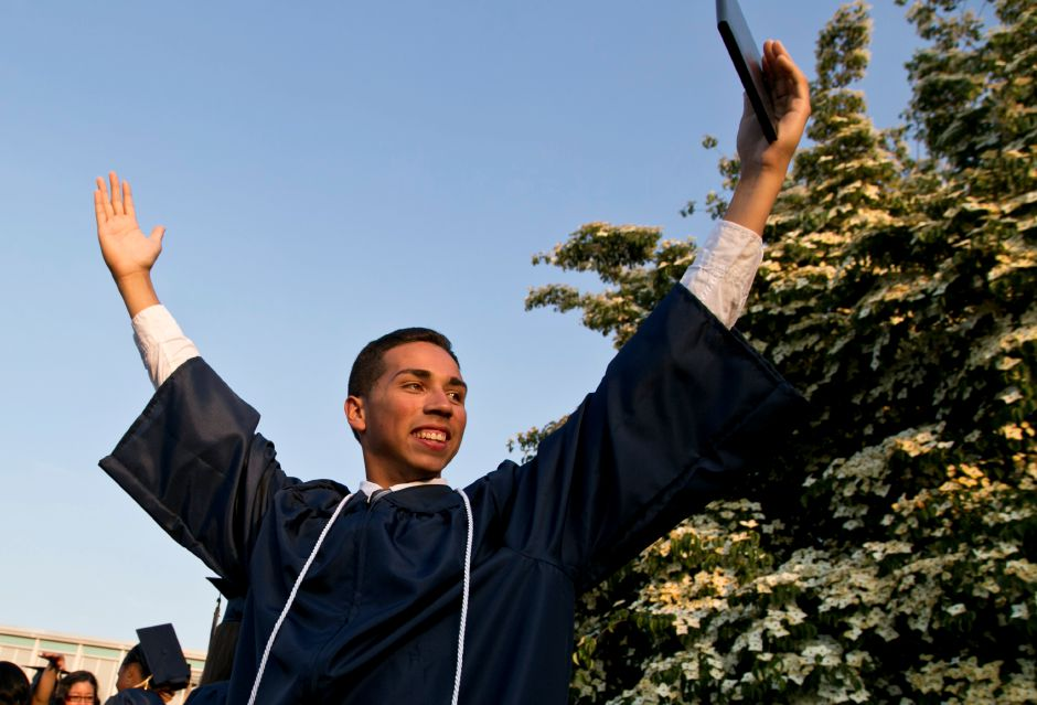 Brandon Valentin holds up his diploma in celebration at the end of the graduation ceremony at Platt High School in Meriden, June 21, 2013. | (Christopher Zajac / Record-Journal)