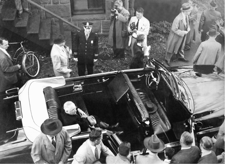 Truman sits in his car after addressing the crowd.| File photo, Record-Journal