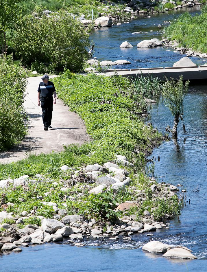 Public Works Director Bob Bass walks along Harbor Brook on the Meriden Green, Thursday, May 24, 2018. Bass is retiring in September after 15 years of service. Dave Zajac, Record-Journal