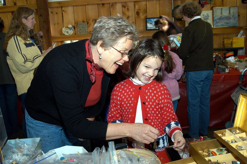 Ruth Formica helps Carolyn Petrowski, of Meriden, do a little Christmas shopping at the Francisean Life Center