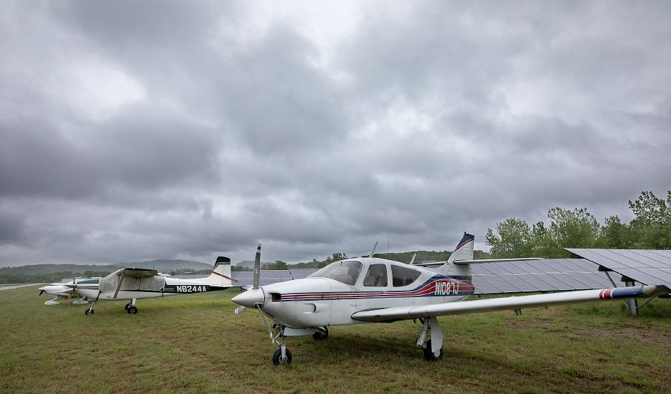 Planes from the recent fly-in parked next to solar panels at Meriden Markham Airport, Monday, May 22, 2017. Construction could begin in upcoming weeks on new taxilanes which will connect the main runway to 16 new hangars to be constructed early next year. | Dave Zajac, Record-Journal