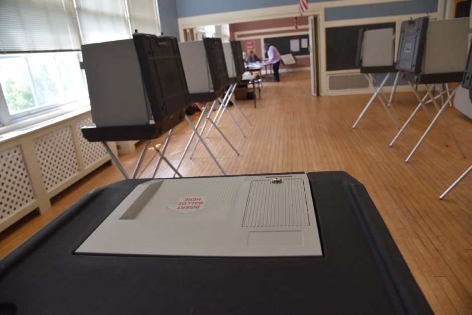 Eligible citizens vote for Regional School District 13