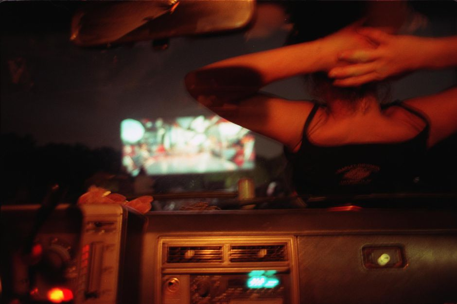 Liz Earnshaw from Middlebury relaxes on the truck Friday night at the Southington Drive Inm Aug. 1999
