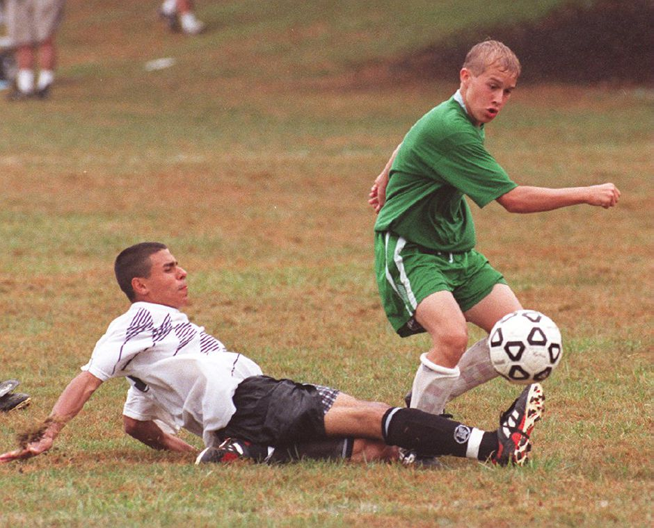 RJ file photo - After slipping to the ground, Brian Blasczyk of the Wallingford Blizzard still tries to keep the ball away from a Naugatuck player, Aug 17, 1998.