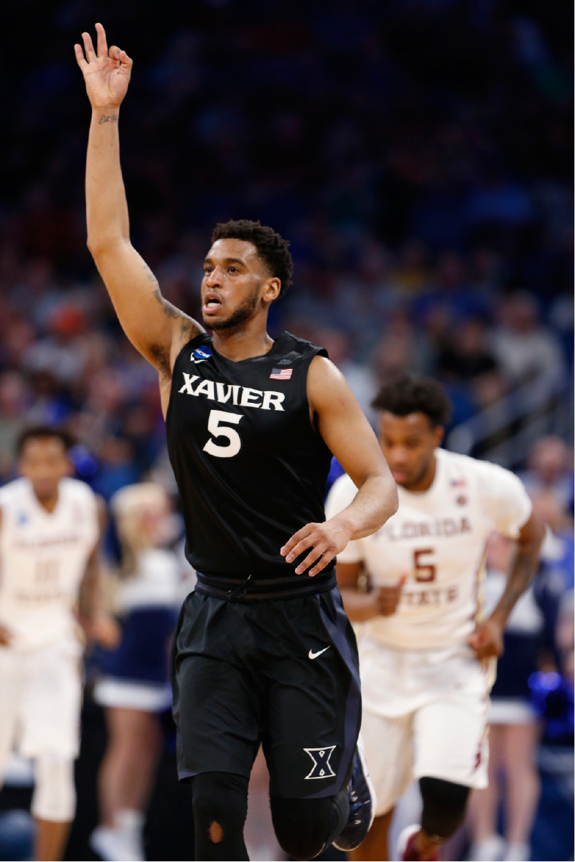Xavier guard Trevon Bluiett (5) celebrates a 3-point shot during the second half against Florida State in the second round of the NCAA men