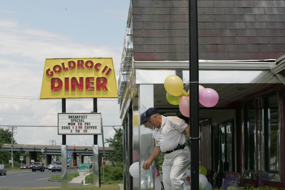 Guri Redzepi, owner of Goldroc II Diner at 461 Queen Street in Southington, steps down from dressing up the entrance with balloons Wednesday afternoon June 22, 2005. The new diner occupies the stop where Bickfords used to be. Chris Angileri/Record-Journal.